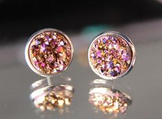 Rose Druzy Stud Earrings / Rose GoldRose Druzy cabochons in a rose gold plated setting. These lovely little earrings sparkle in shades of Rose, Gold, Maroons,