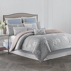 The Daisy Comforter Set is inspired by Wedgwood's popular Tea Story collection. This luxurious comforter set draws on a rich archive of color and pattern to create a sophisticated and romantic palette of black, blue, pink, and gold.