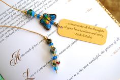 Turquoise and gold cloisonné beaded bookmark with butterfly bead on gold thread with Bahai quotation on gold card, Page book holder by elikamahony on Etsy