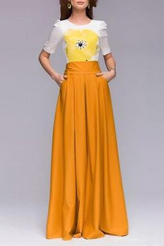 I'm not convinced that I love this one... but it's cute. Yellow Floral Short Sleeve Maxi Dress