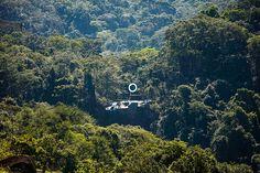 mariko mori sites luminous ring at the peak of a cascading waterfall in brazil