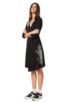 Desigual women's V-neck black dress with crossover top, 3/4 sleeves and white floral detail. Check our Women's collection!