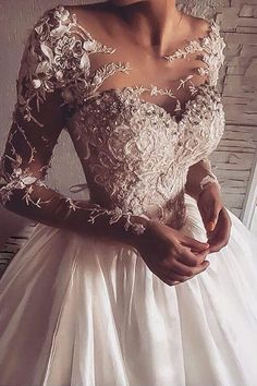 Goegeous Illusion Jewel Neck Long Sleeves Sweep Train Wedding Dress with Appliques Illusion Back
