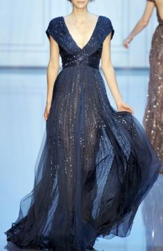 Shimmery dark blue evening gown / 47 Mysterious Midnight Blue Wedding Ideas | HappyWedd.com / Runway, model