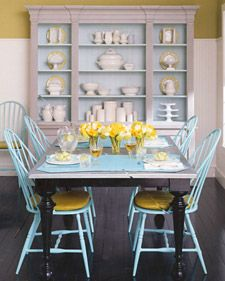 Love the use of color on all of the different wood pieces.   (painted windsor chairs)