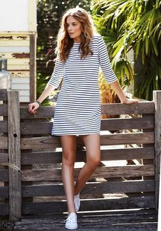 {Striped dress and white sneakers.}