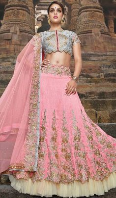 Savor the adulation that breeze your way adorned in this lehenga choli in pink color embroidered silk. The lace, resham and stones work appears to be like chic and fantastic for any get together.  #rosepinkshadechaniyacholi #indiandesignghagaracholis #adorablelooklehengacholie