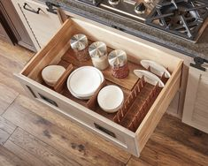 When the barn doors are closed, the top drawer is dressed in a deep drawer organizer with dividers and a deep drawer vertical plate holder, making it easier to store multiple sized cooking items. Kitchen Wall Storage, Dish Storage, Plate Storage, Kitchen Drawers, Storage Drawers, Utensil Drawer Organization, Kitchen Organization, Spice Drawer, Top Drawer