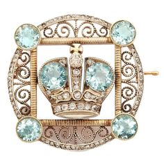 Faberge Aquamarine Diamond Gold Imperial Presentation Brooch  | From a unique collection of vintage brooches at https://www.1stdibs.com/jewelry/brooches/brooches/