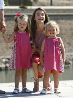 Pin for Later: Get to Know Spain's Queen Letizia  Princess Letizia of Spain posed with her two daughters during a family walk in August 2009.