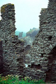 Ruins at Tintagel Castle....Perhaps the most familiar of all the sites associated with Arthur. Local tradition, founded largely on the writings of Geoffrey of Monmouth in his twelfth-century History of the Kings of Britain, claims this is the birthplace of Arthur.