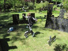 batman leaping over cars in the city - obstacle course for his birthday party