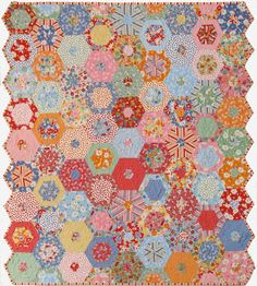 "Finished size 45"" x 51""  This quilt was made with a jelly roll and a honey bun of Snippets fabric by American Jane for Moda."