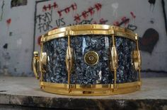 """Gretsch 14 x 6.5"""" Custom maple snare drum with gold hardware finished in Black Marine Nitron  wrap."""