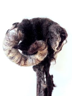 The Aries Ram headdress hand felted by Karen Rao using a blend of natural wools and raw black sheep's fleece. Aries Ram, Animal Hats, Black Sheep, Felt Animals, Headdress, Wearable Art, Handmade Gifts, Lion Sculpture, Etsy Seller