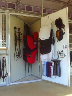 Awesome idea! It's the front corner of the horse's stall...no boxes in the aisle and no separate tack room! Brilliant.