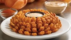Texas Roadhouse Coupon for a free bloomin onion.