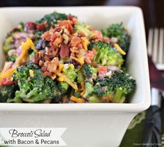 This fresh and crunchy Broccoli Salad is such a simple side dish to make year-round. It's fully dressed with bacon, pecans, cheese and a creamy homemade dressing.