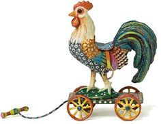 Amanda E. Skinner – Miniatures Rooster A rooster cast in metal on a wooden platform. Leather saddle, metal wheels and brass stirrups.  L: 1.75 in. W: 1 in. H: 2.5 in.