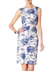 A floral jacquard dress featuring asymmetric seam detail for a flattering fit. Styled with a slash neck, centre back vent and concealed zip fastening. Fully lined for comfort.