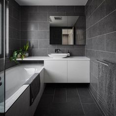 The Dept. of Design Canberra - a residential bathroom interior featuring one of our charcoal tiles with grey undertones. Using the same tile floor and wall creates a seamless look as there is no point of break. This bathroom looks indulgent! Bathroom Floor Tiles, Wood Bathroom, Bathroom Renos, Bathroom Layout, Modern Bathroom Design, Bathroom Colors, Bathroom Renovations, Bathroom Interior, Small Bathroom