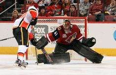 GLENDALE, AZ - DECEMBER 19: Goalie Mike Smith #41 of the Arizona Coyotes makes a pad save on the shot by Matthew Tkachuk #19 of the Calgary Flames during the third period at Gila River Arena on December 19, 2016 in Glendale, Arizona. (Photo by Norm Hall/NHLI via Getty Images)