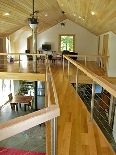 Photo: Upper level Catwalk using Round Stainless Steel Post, and Custom Wood Top Rail, with Stainless Cable Rail Infill from Stainless Cable & Railing Inc in Campton NH.  For more Deck Railing Ideas visit us at http://stainlesscablerailing.com/cable-railing-photo-gallery.html