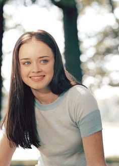 "Rory Gilmore is one of the two protagonists on WB drama Gilmore Girls. She is portrayed by Alexis Bledel. Rory is the daughter of Lorelai Gilmore and Christopher Hayden and the older half-sister to Gigi. She is the only granddaughter of Richard and Emily Gilmore. She is considered to be a specially gifted child. At the start of the series, she is a sophomore in high school, and when the series concludes, she is a recent college graduate. Lorelai ""Rory"" Leigh Gilmore is the only daug..."