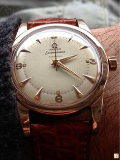 Gold vintage Omega with leather strap - a must have for that classic look.