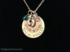 Personalized Metal Stamped Necklace with Baby Feet Charm and Two Names & Birthdays. $25.00, via Etsy.