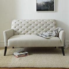 contemporary deep buttoned, narrow arm sofa.