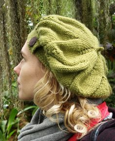 A slouchy beret featuring a large lace flower pattern and knit on band in a firm, textured stitch pattern with decorative button. The pattern is worked from the top down and the band is knit onto the live hat stitches at the end. Verity uses a worsted weight yarn and the pattern is given in four sizes so you can be sure of a perfect fit.