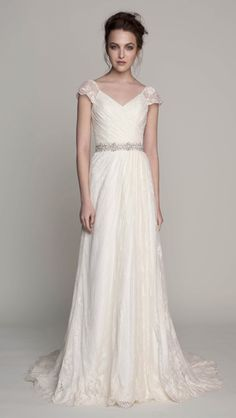 Kelly Faetanini's MADELINE.  Chantilly lace cap sleeve gown with ruched bodice and sequin spray. *Sash sold separately