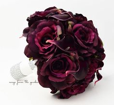 Plum silk roses with Real Touch plum calla lilies create a lovely bridal bouquet that can be yours to have & to hold on your wedding day! I can create it for you as shown or customize it to fit your c