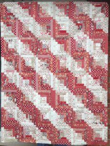 Straight Furrows Log Cabin Quilt top by Jen Crutchfield.