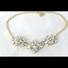 *Final Sale!* Crystal Flower Necklace This stunning crystal necklace speaks for itself! A perfect piece to add glam to your everyday outfit, jeans, skinny jeans or that special night out. Or, my favorite is just with a simple tee. You will love love the sparkle this necklace creates! Length: 20 inches with 2 inch extender chain for adjustable length. New in package. Retail price: $49.99. Price firm even if bundled. Jewelry Necklaces
