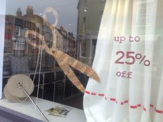 Summer sale window display with giant scissors made from cardboard and wallpaper Christmas Window Display, Window Display Design, Store Window Displays, Retail Windows, Store Windows, Perfume, Visual Display, Retail Interior, Window Dressings