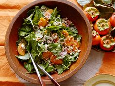 Kale and Persimmon Salad with Pecan Vinaigrette : Persimmons are the perfect newcomer to the Thanksgiving table. Their subtle sweetness melds beautifully with the sharpness from the pickled shallots and creaminess of the cheese in this pretty, fall-inspired salad. If you can't find persimmons, dried apricots plumped in orange juice will stand in nicely. via Food Network