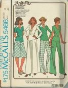 An unused original ca. 1977 McCall's pattern 5466.  Pullover tops with long or short sleeves have V neckline, and optional purchased belt; dickey with collar snaps to top.  Bias skirt in two lengths, and pants have elastic in waistline casing.