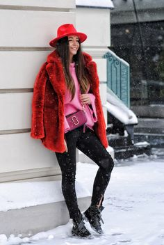 Red faux fur coat in combo with a pink sweater