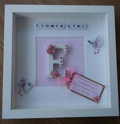 "PERFECT AS A GIFT FOR A BRIDESMAID, FLOWER GIRL OR MAID OF HONOUR. A WHITE LETTER OF YOUR CHOICE DECORATED WITH MULBERRY PAPER ROSES, DIAMANTES AND A WOODEN HEART SITS IN THE CENTER. YOU ARE BUYING A 10 x 10"" SCRABBLE ART FRAME IN WHITE. 
