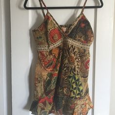 Baby doll tank Adjustable V neck baby doll tank with elastic back panel. Warm color print. Hits just below hip. Can dress up or down, lightweight, feminine! Bhag's Tops Tank Tops