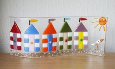 This is a beautiful fused Glass freestanding Double Curved Panel with Beach Hut Design handmade by my Husband Mark John and being fired in a digitally controlled Kiln by 1400 Degrees. Colour: Clear, Multicoloured Beach Huts Size: 24cm x 10cm Thanks for looking Doris