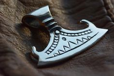 A personal favorite from my Etsy shop https://www.etsy.com/listing/177655357/late-viking-period-axe-pendant