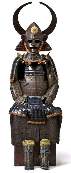 Haruta-School Kabuto and an Okegawa Do. Helmet by Haruta Tokimune,Edo period, 18th century The russet-iron armor laced in dark blue and orange with the components lacquered black and comprising a momonari kabuto mounted with a five-lame shikoro with...