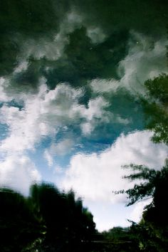 impressionistic photography of clouds in water reflection  I switzerland aare river I landscape nature