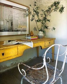 a repin....but, love this yellow desk and wrought iron chair