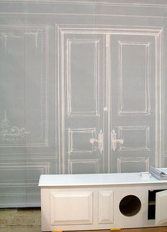 trompe l'oeil canvas. Really cool, but I'm looking at that white cabinet, my kittens would love it :3