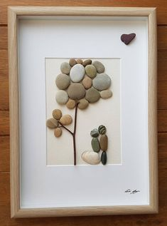 Description A beautiful and unique handmade pebble art picture of Couple kissing under tree. This picture is a lovely home decoration and would make a perfect gift. The picture is made using pebbles, sea shell, wood and thin jewellery wire. All materials are carefully placed and fixed