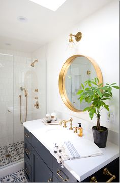 cement tile floors, smokey vanity and brass/gold accents